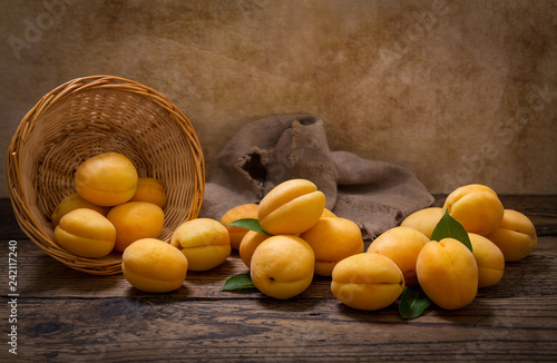 fresh apricots in a basket - 242117240