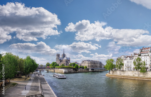 Leinwandbild Motiv Panorama with Notre Dame cathedral and boat on Seine in Paris, France