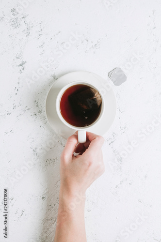 Cup of tea on white background. Top view