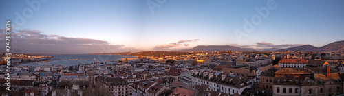 Panoramic cityscapes of Geneva in Switzerland.  The images show the rooftops of Geneva and the surrounding mountains at sunset as the sunlight reflects off the roofs and windows of the buildings. - 242130615