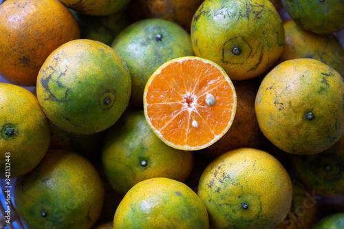 Fresh Orange cut half on pile of oranges, select focus.