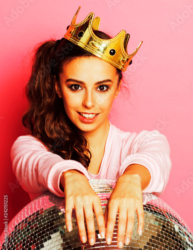 young cute disco girl on pink background with disco ball and cro - 242151225