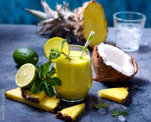 Pineapple, coconut cocktail or smoothie, tropical fruit refreshing summer drink with mint