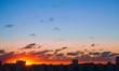 Dramatic sunset over large city landscape