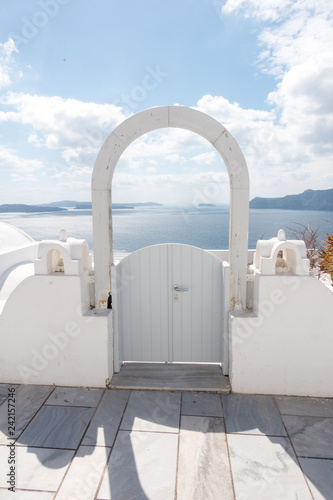 Oia town on Santorini island, Greece. Traditional architecture - 242157246