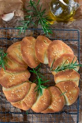 Serbian leavened pull apart flatbread pogaca with sesame seeds