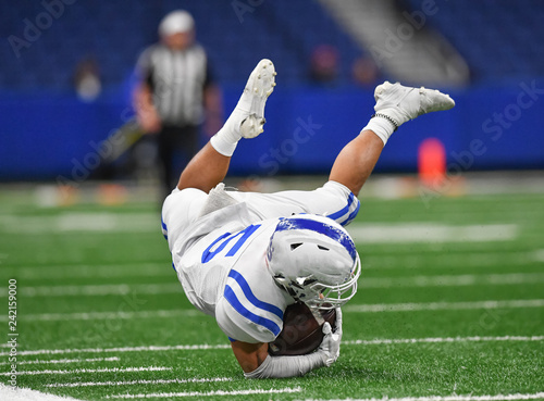 Great action photos of high school football players making amazing plays during a football game