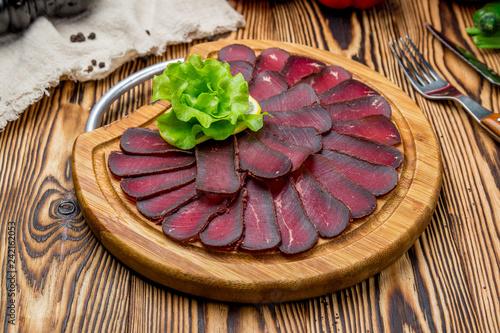 Dried sliced basturma on the Board - 242162053