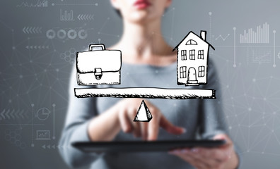 Work and life balance with business woman using a tablet computer