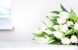 Fototapeta Tulipany - White flowers bouquet on table,women's or mother's day background. © nys