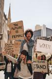 Women enjoying during a demonstration on road - 242165287