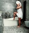 Leinwanddruck Bild - Woman in towel and bathroom interior