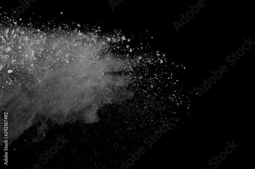White powder explosion isolated on black background.