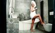 Leinwanddruck Bild - Woman in towel and body care