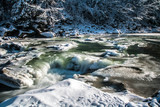 icy stone bath of small waterfall, smooth water