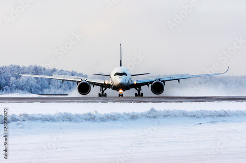 Modern commercial passenger plane on airfield. Jet on runway. Aviation and transportation.