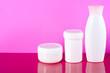 Leinwanddruck Bild - White jar of cream, gel shower, lotion beauty on pink background