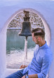 LINDOS,RHODES/GREECE NOVEMBER 1 2018 : ST Paul's bay,man sitting in the church's bell.