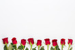 Red rose flowers on white background. Flat lay, top view, copy space.