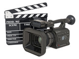 Cinema concept. Professional video camera with clapperboard, 3D rendering - 242204099