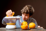 young man make juice with fresh orange b - 242207461