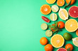 Leinwandbild Motiv Different citrus fruits on color background, top view. Space for text