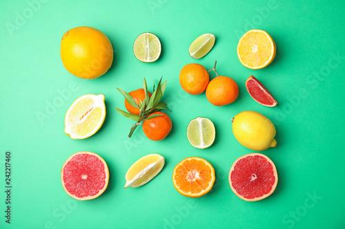 Leinwandbild Motiv Different citrus fruits on color background, flat lay