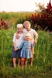 Three Sweet Little Farm Children Posing for Portrait in Country Garden - 242221062