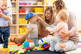 Group of moms with their babies at playgroup