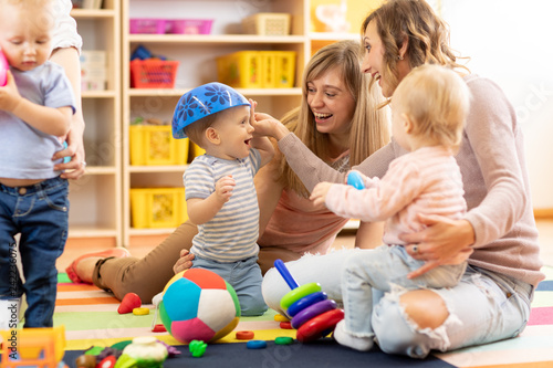 Group of moms with their babies at playgroup - 242236075