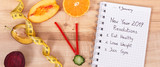 New year resolutions for 2019 and clock made of fruits with vegetables and tape measure