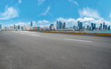 Empty asphalt road along modern commercial buildings in China,s cities - 242238899