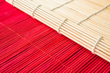 Fototapeta Bambus - Striped bamboo mat for table setting. © Evgeny