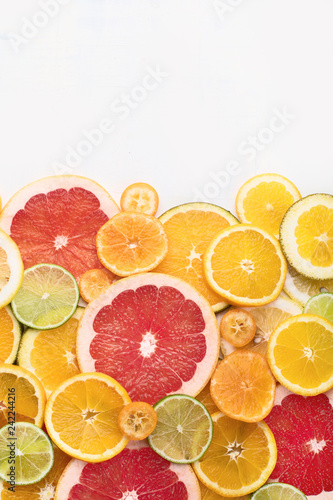Fresh citrus fruits colorful background