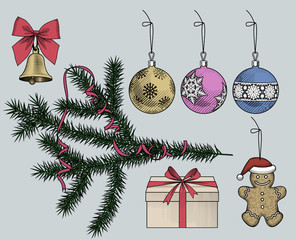 Set of Christmas ornaments and tree branch with a ribbon © Raman Maisei
