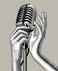 Female hands with a retro microphone © Raman Maisei