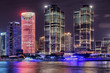 Night view of modern waterfront buildings in Shanghai, China