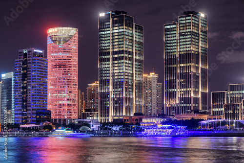 Foto Murales Night view of modern waterfront buildings in Shanghai, China