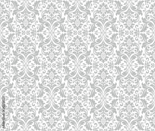 Wallpaper in the style of Baroque. Seamless vector background. White and grey floral ornament. Graphic pattern for fabric, wallpaper, packaging. Ornate Damask flower ornament. - 242258221