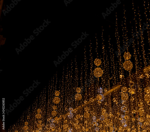 Foto Murales light from the garlands on a black background