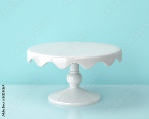 White porcelain cake stand on blue backgroung