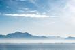 Chiemsee mit Bergen und Nebel