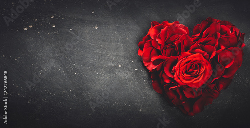 Foto Murales Heart-shaped red roses on stone background.