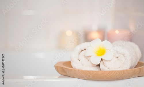 Spa still life setting with frangipani flower and towels