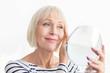 Leinwanddruck Bild - Senior woman touching her soft face skin