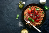 Whole grain spaghetti pasta with grilled cherry tomato.Top view with copy space.