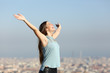 Leinwanddruck Bild - Excited woman raising arms celebrating vacation