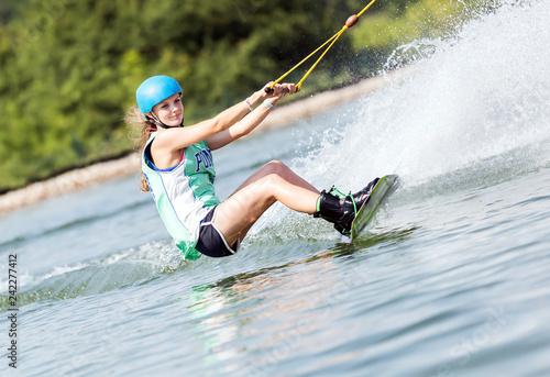 Foto Murales Frau beim Wassersport