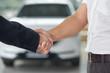 Handshake close up in car dealership.