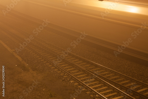 Foto Murales Railroad near train station at foggy night